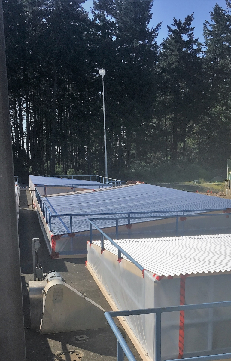 The figure below shows the temporary covers installed over the primary clarifiers at the Comox Valley water pollution control centre