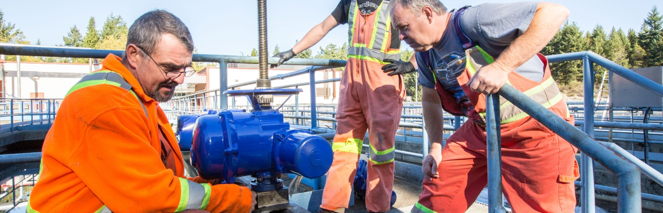 sewage treatment plant operators conducting maintenance
